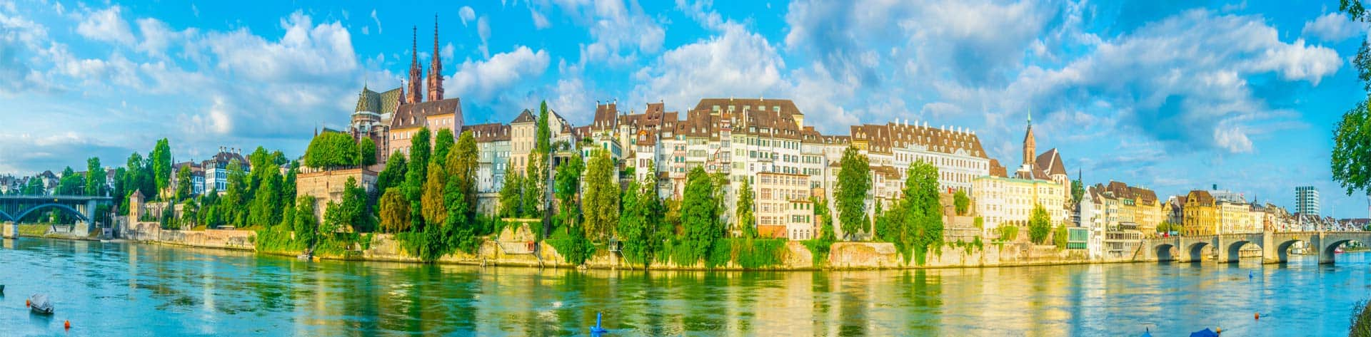 Riverside Of Rhine In Basel Dominated By Majestic Building Of Munster Church Switzerland AdobeStock 234796577 1920x